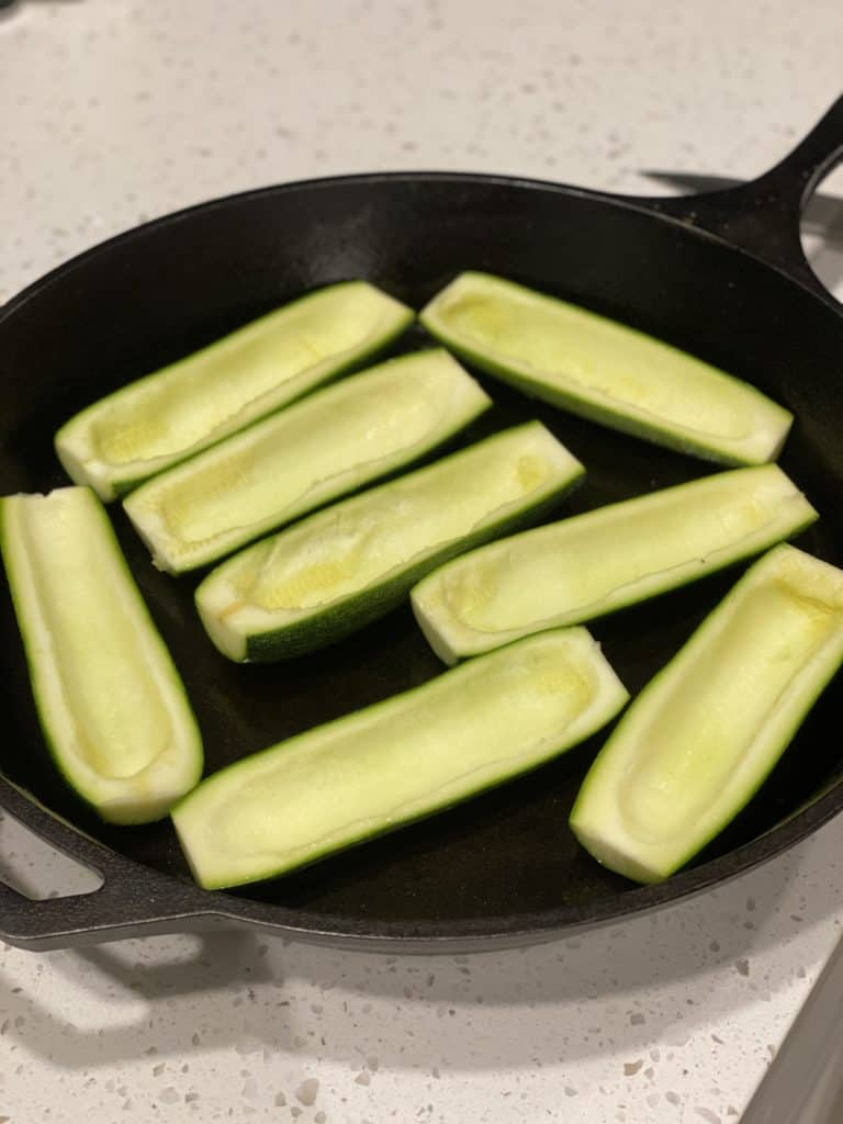 zucchini boats in a cast iron pan