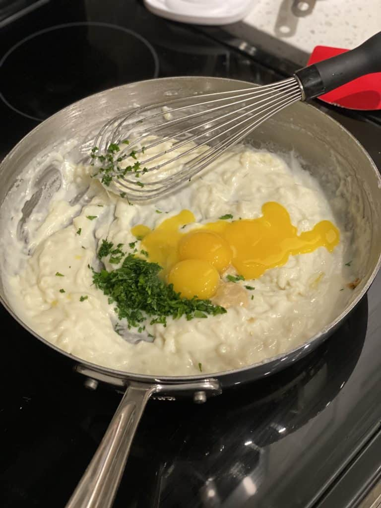 ingredients for a cheese soufflé in a pan
