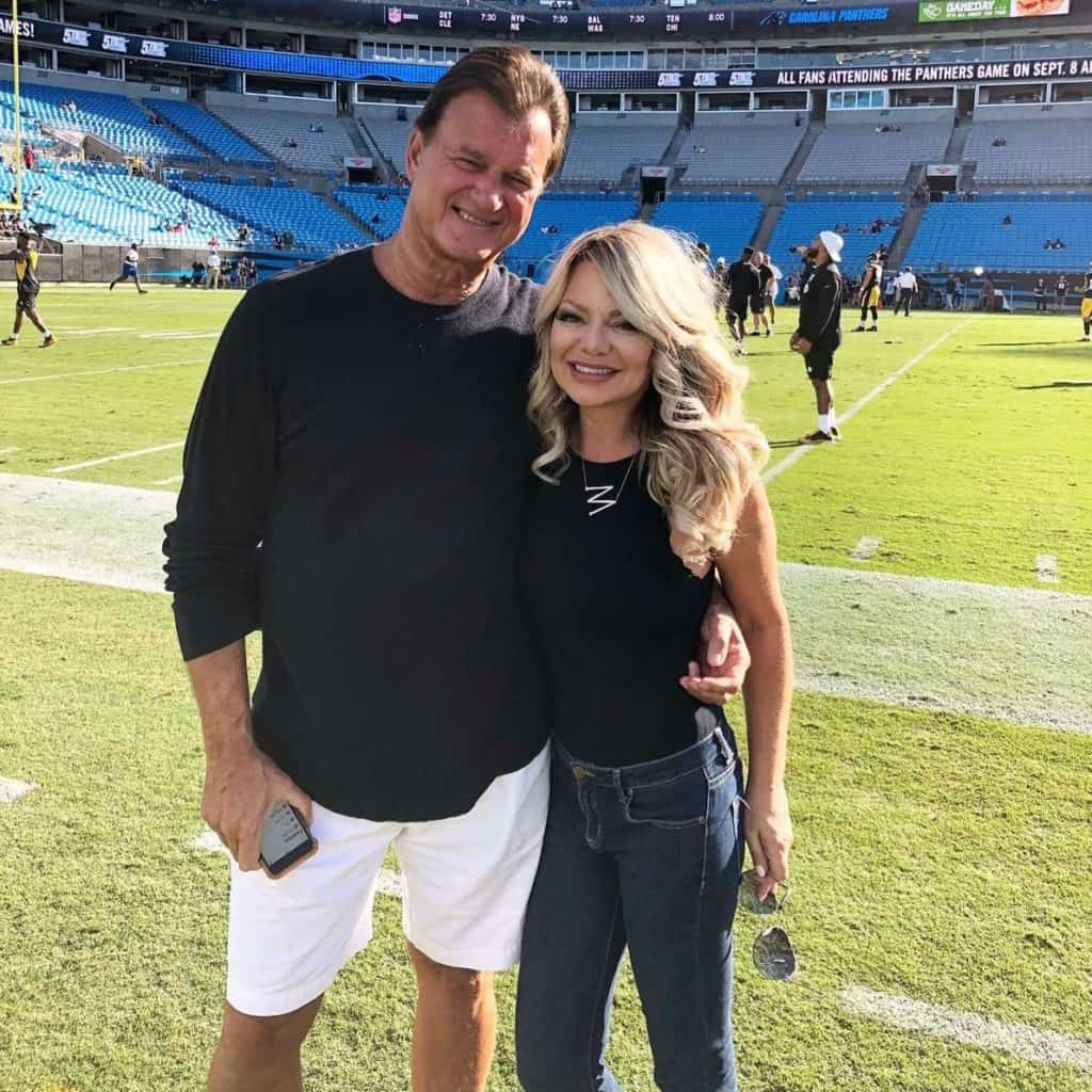 a photo of me and my husband on a football field