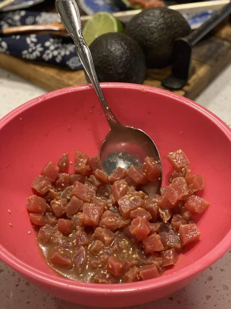 raw tuna diced in a pink bowl with sauce