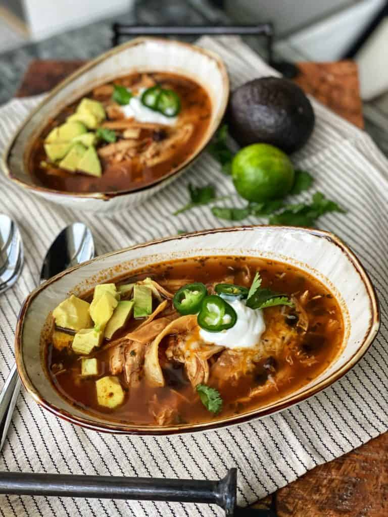 two bowls of keto chicken tortilla soup