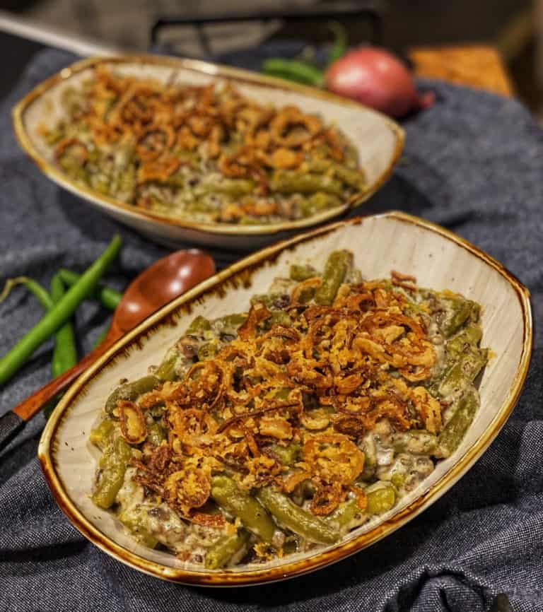 two casserole dishes filled with homemade green bean casserole