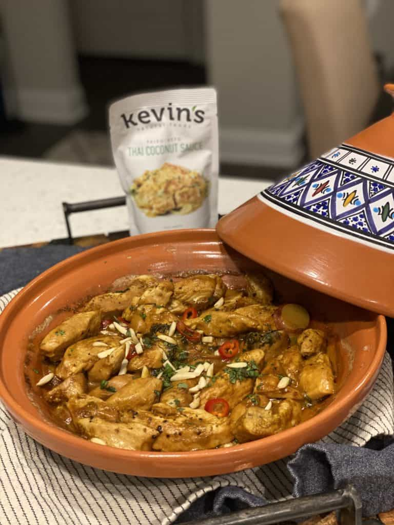 Thai coconut chicken tagine with a pouch of Kevin's Natural Food sauce in the background