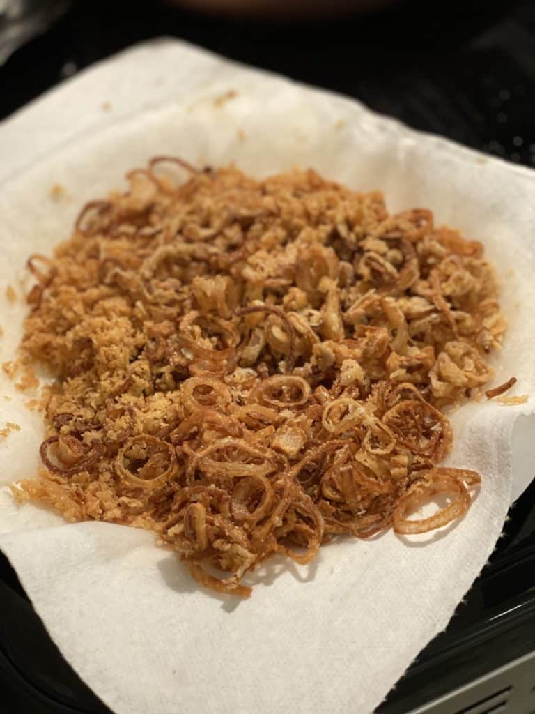 fried shallots on paper towels for homemade green bean casserole