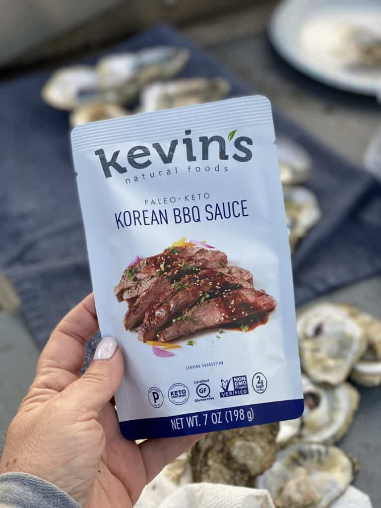 me holding a pouch of Kevin's Natural Foods Korean BBQ Sauce