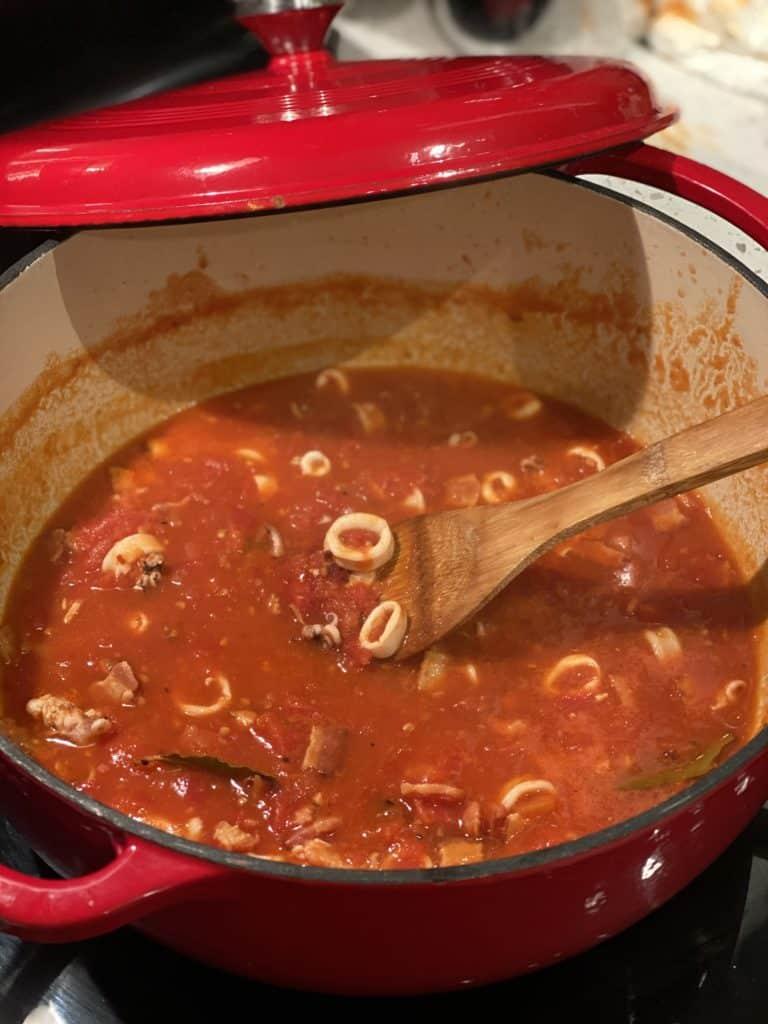 a red pot of spicy calamari sauce