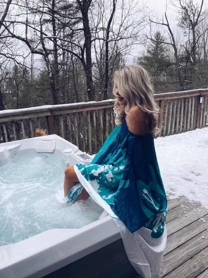 me sitting on the edge of a hot tub in a blue coverup