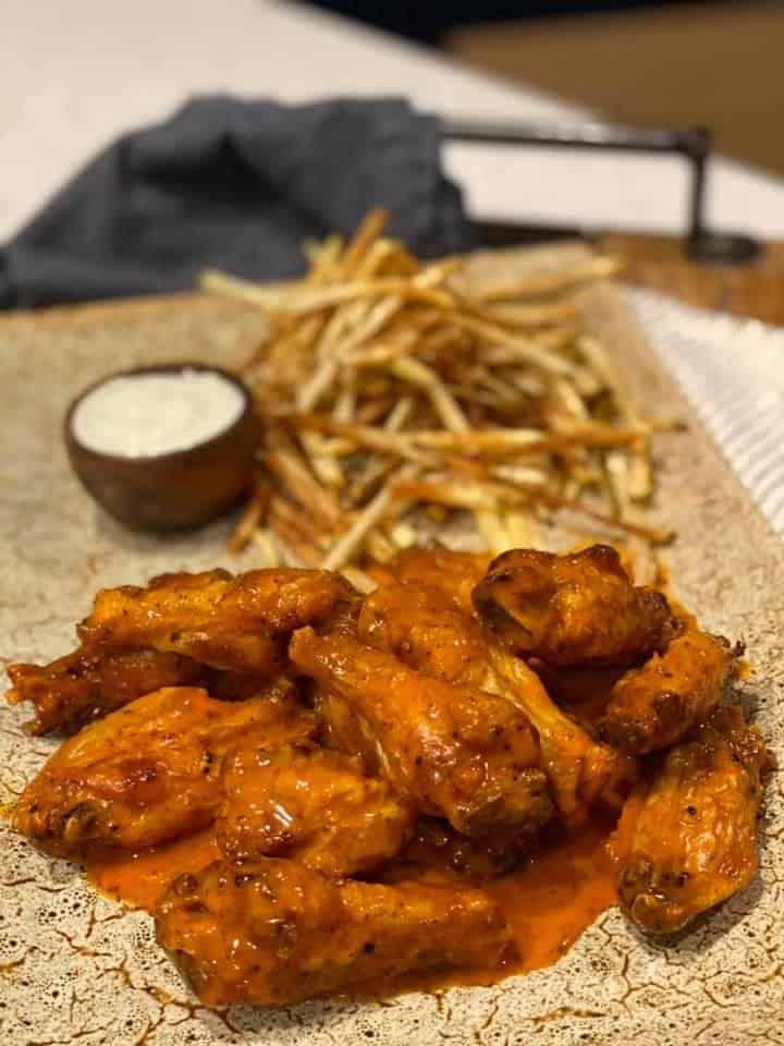 a platter of air-fryer chicken wings buffalo style