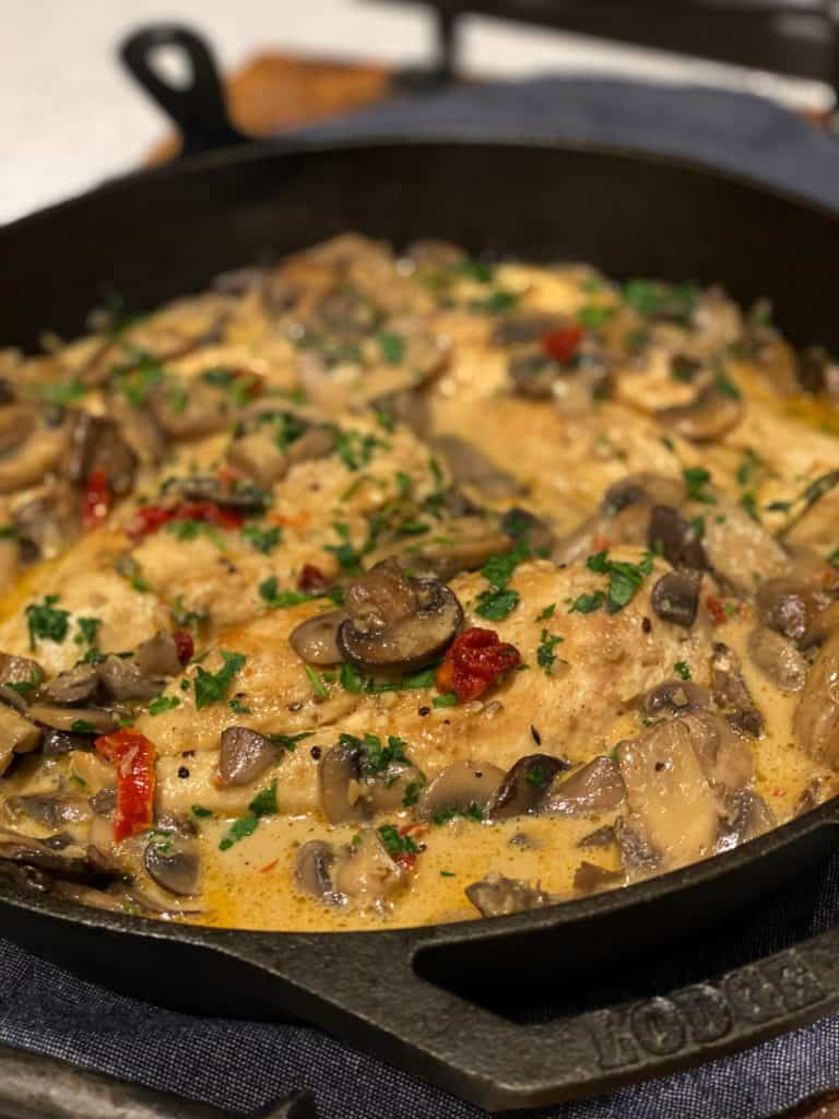 a cast iron pan of easy chicken and mushrooms