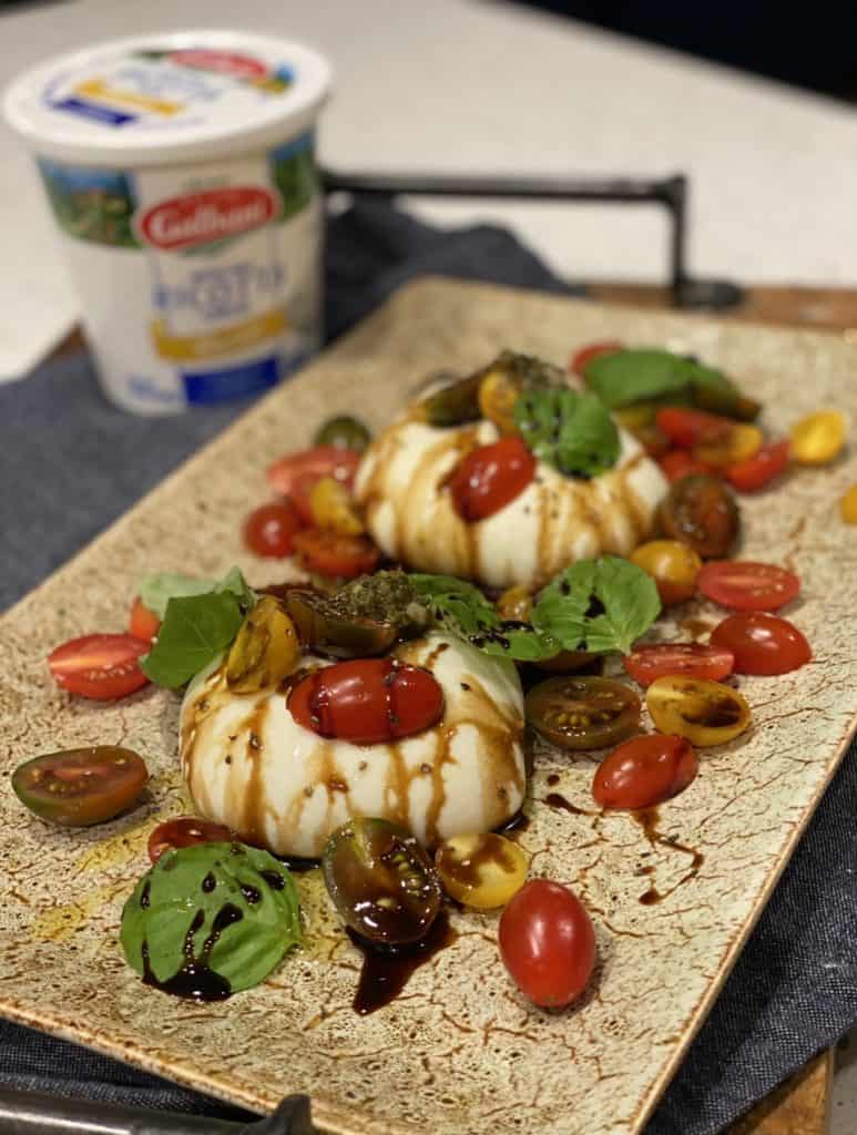a platter of two pieces of homemade burrata salad