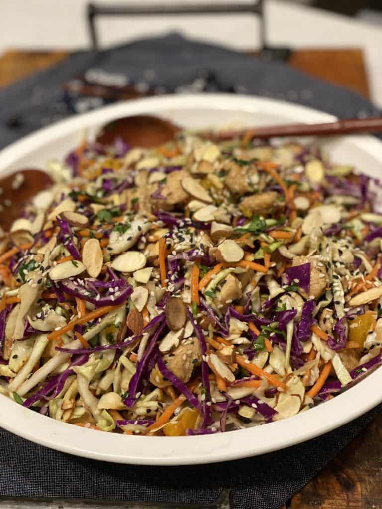 Crunchy Asian chicken salad in a flat round bowl