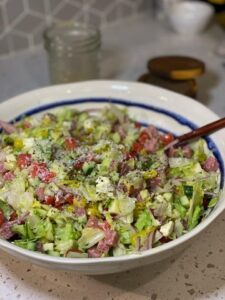 a white bowl filled with antipasto chopped salad