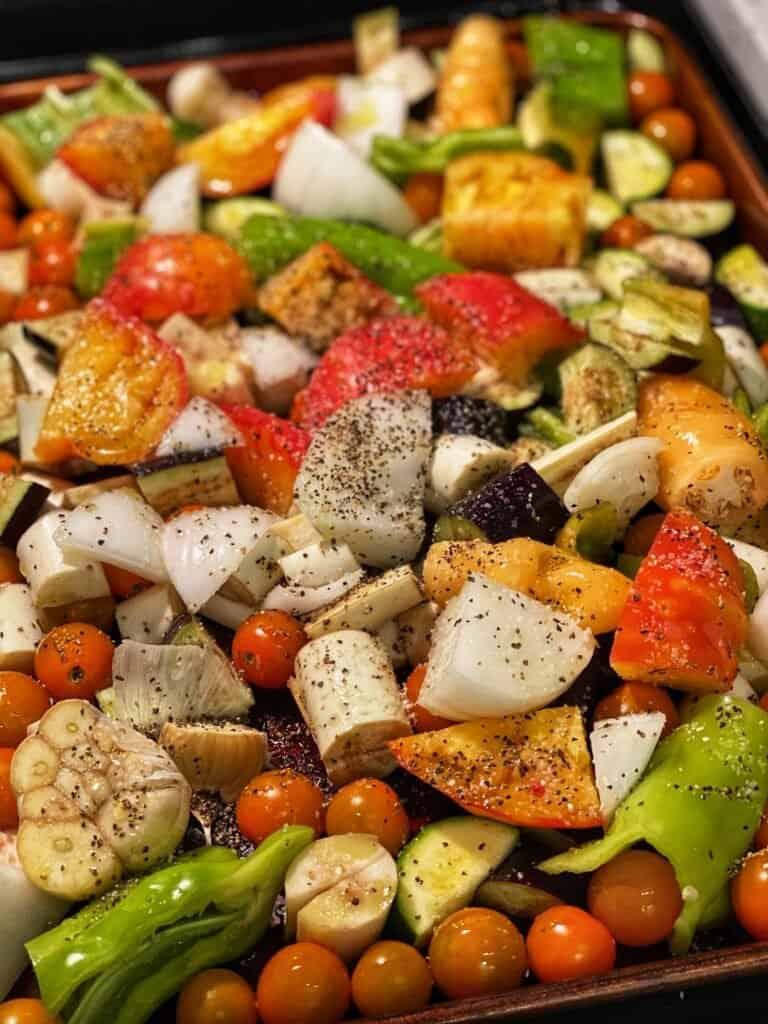 a sheet pan full of fresh vegetables for roasting
